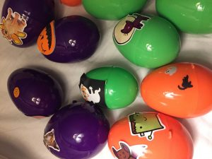 Easter eggs decorated with Halloween stickers