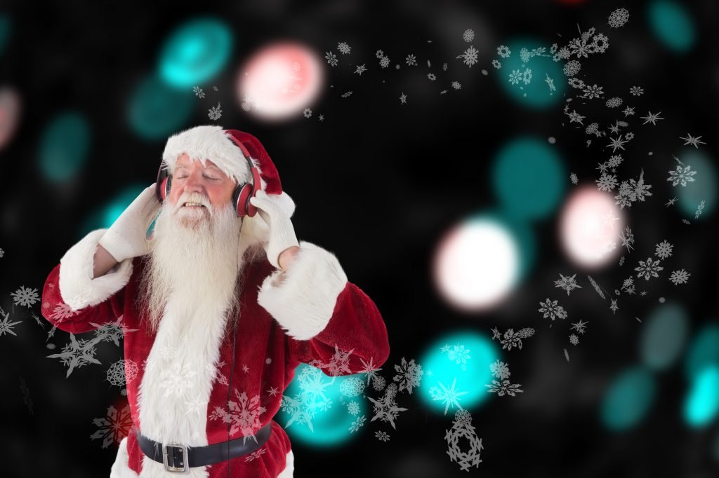 Santa Clause with music headphones on