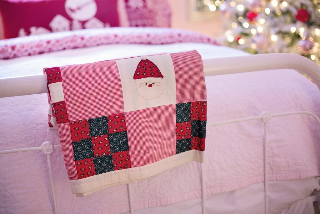 bed with Christmas quilt
