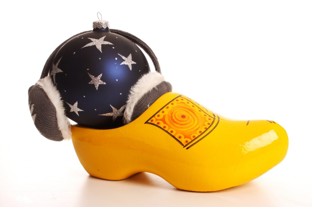 yellow wooden clog with blue Christmas ornament