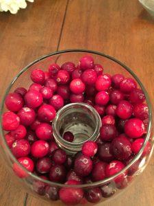 cranberries filling a glass vase