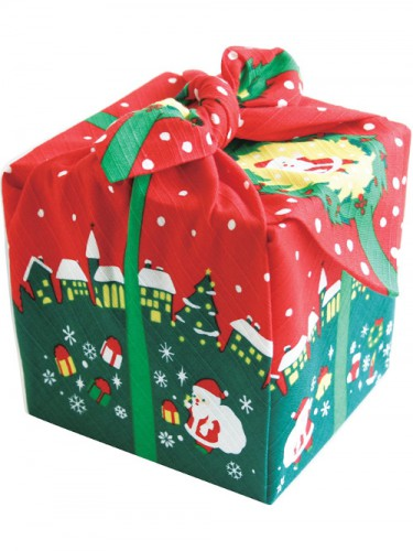 Gift box wrapped in red and green fabric with a Christmas print