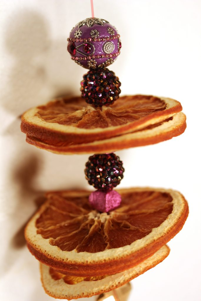 Doorknob hanger with dried orange slices and purple beads