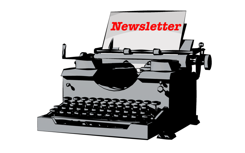 Image of a typewriter with a newsletter in it