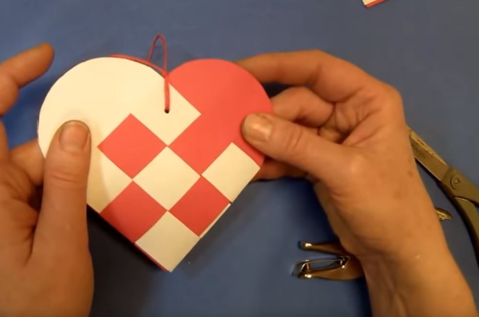 making a paper woven heart basket