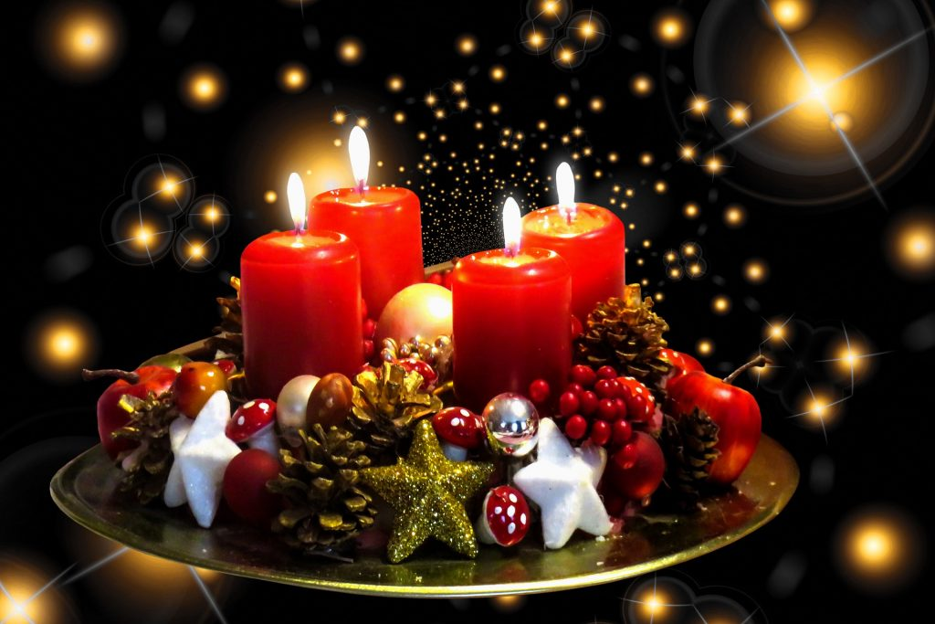 Red candles in a centerpiece against a black background