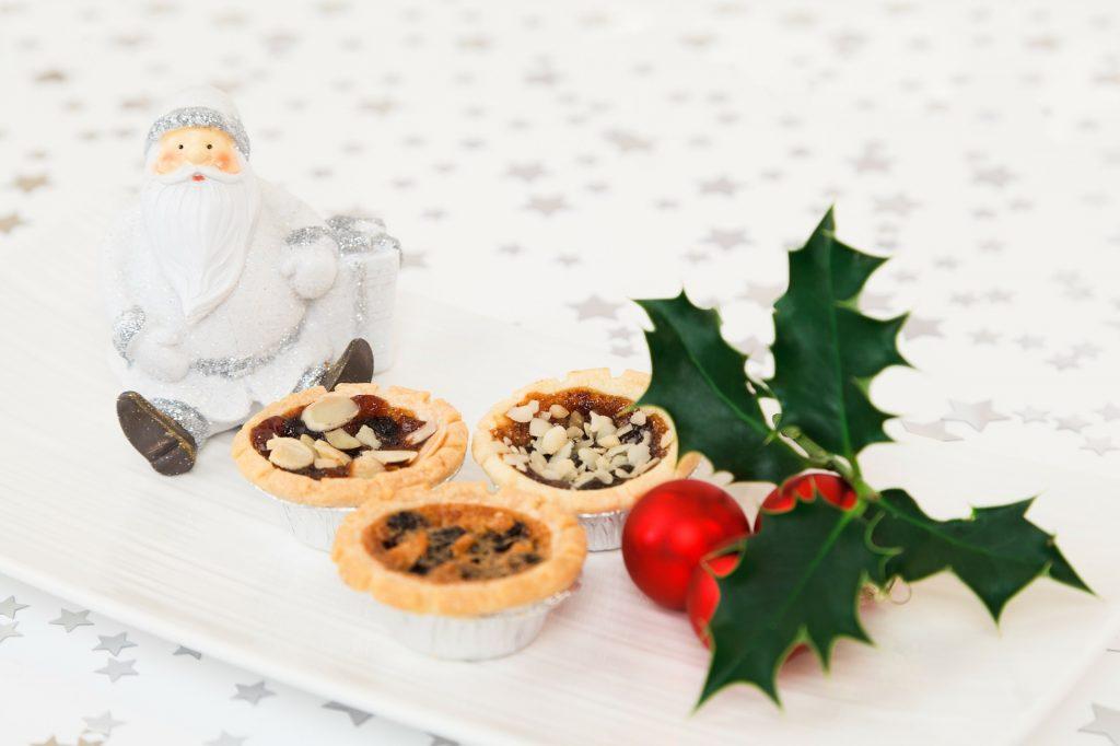 Santa figurine with 3 small pies