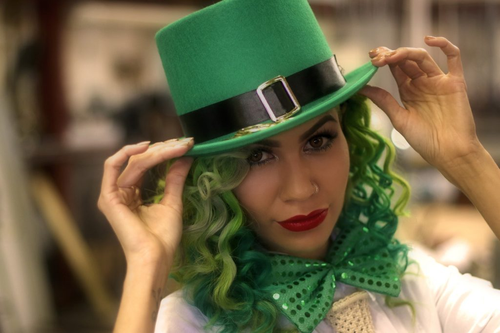 Woman dressed in green hair and hat for St Patrick's Day